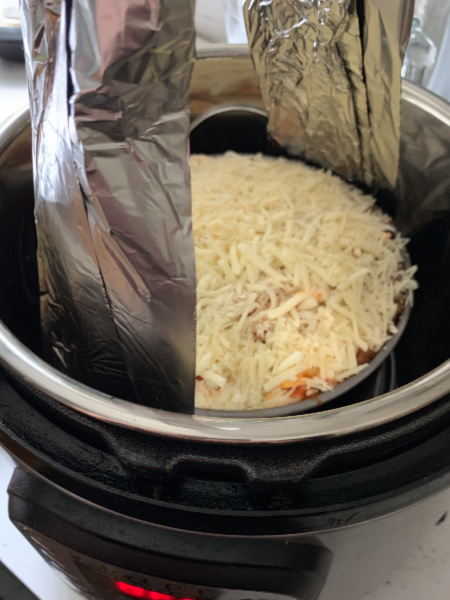 A lasagna inside an instant pot.