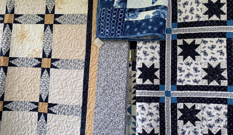 Blue themed quilts on display at Shaker Village Craft Show
