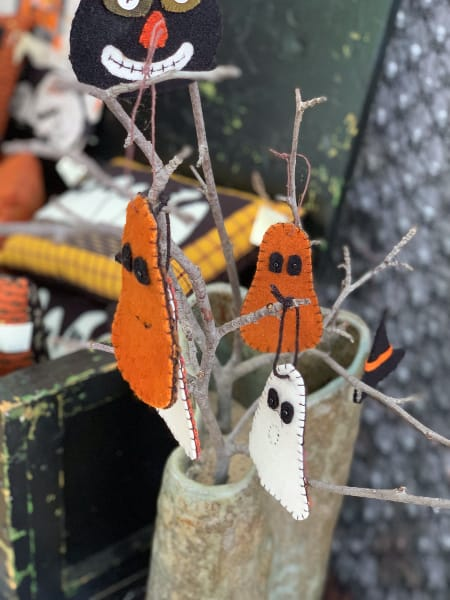 Felt Ghost Ornaments in a booth at Shaker Village Craft Fair