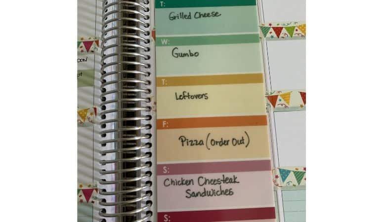 a written on meal plan on an Erin Condren dashboard